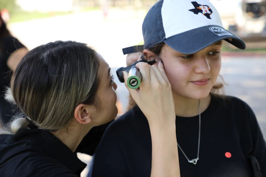 Young lady getting her hearing checked