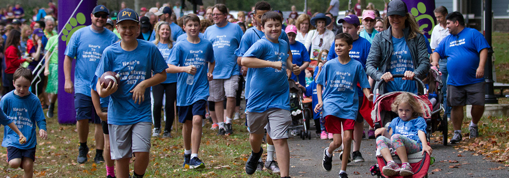 children running at the start of a walk