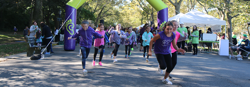 photo of kids running at the start of the walk