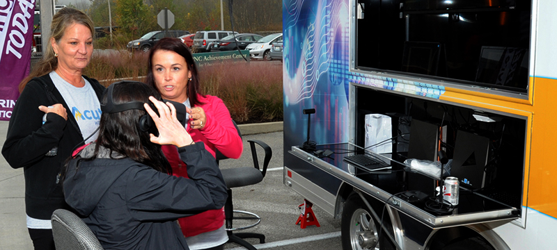 individual getting a screening at a hearing screening van